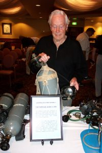 Photo of Ted Eldred in 2003 with an example of the world's first commercially available, single hose scuba unit, which was released early in 1952.